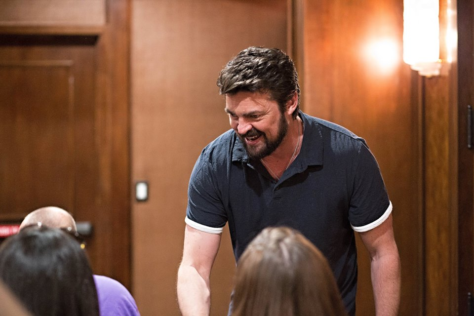 Karl Urban shaking hands