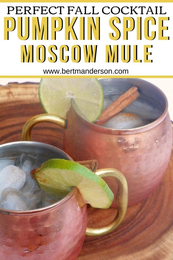 Pumpkin Spice Moscow Mule - the perfect fall cocktail shown in copper mugs with cinnamon stick and lime wedge