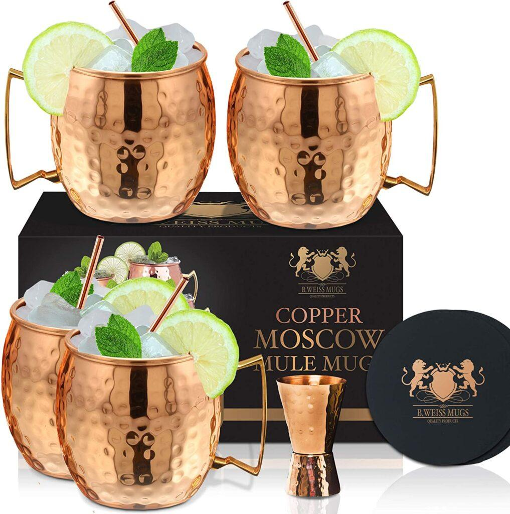 Set of four Copper Moscow Mule Mugs with shot glass and straws