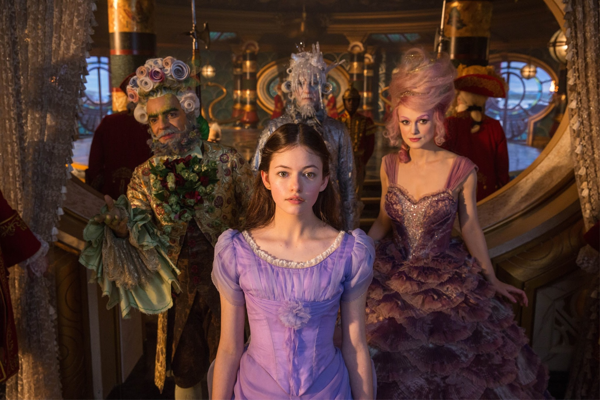 Clara and three of the four characters in charge of the four realms