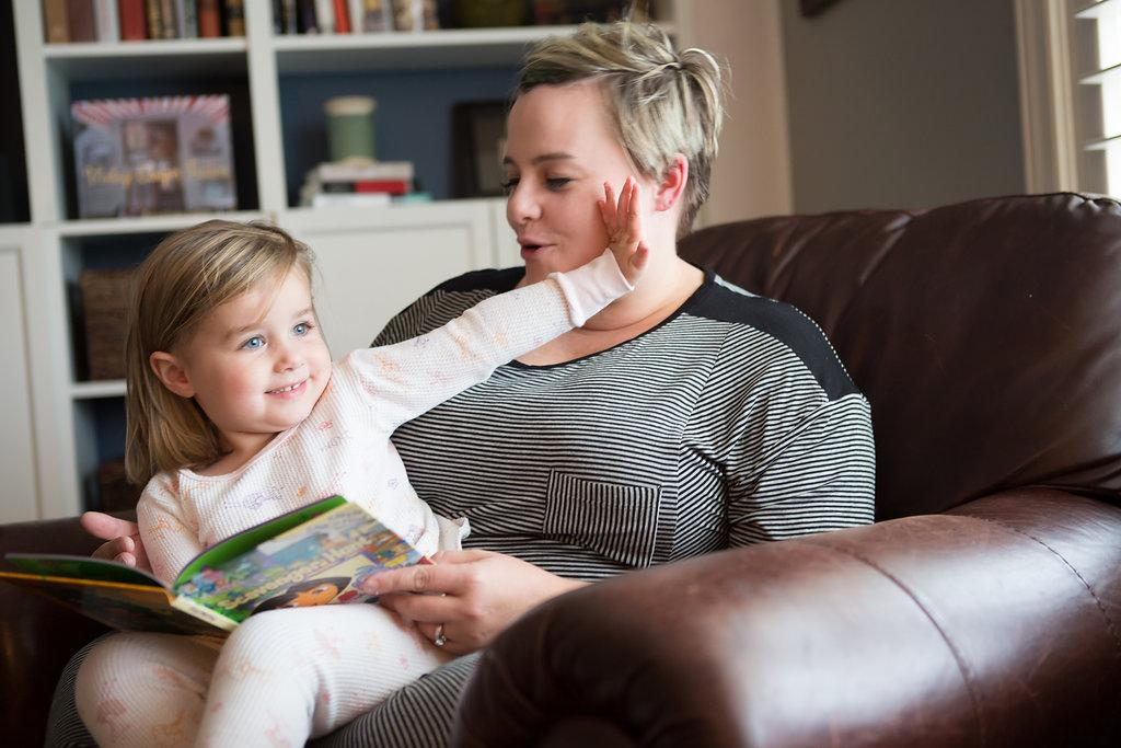 Mom trying to read to child