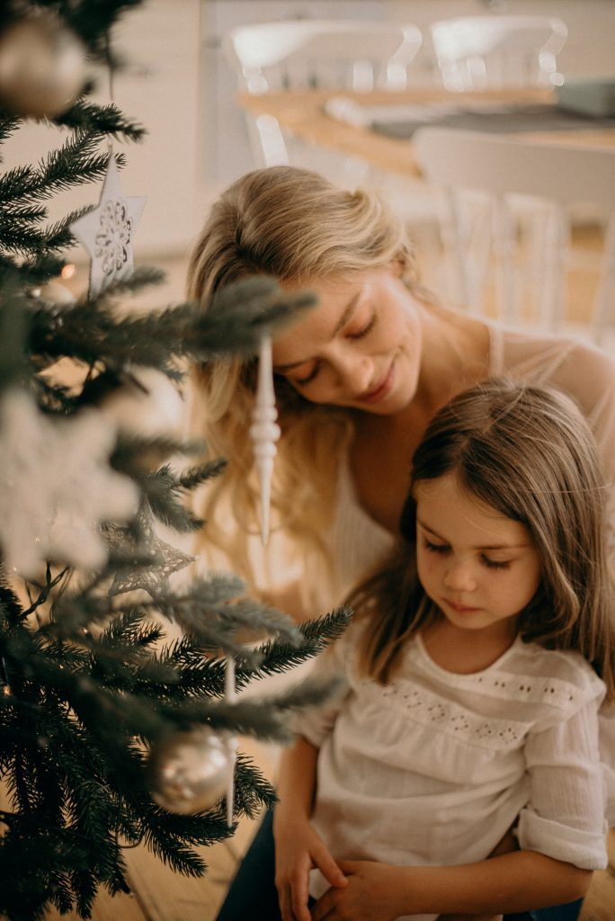mom and daughter by christmas tree